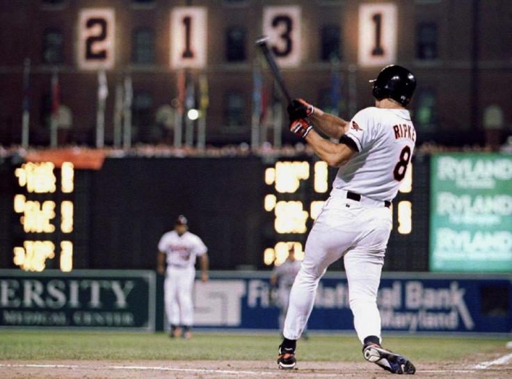 File photo of Baltimore Orioles Cal Ripken Jr. hittng a base hit in the eighth inning of his 2, 131st consecutive game in Baltimore