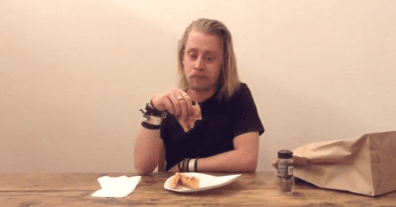 Macaulay-Culkin-Eating-a-Slice-of-Pizza