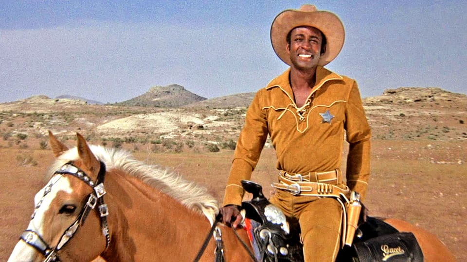 an analysis of satirical western films in blazing saddles a film Movie analysis #4 i think the genre that best fits blazing saddles is satire while this convention is typical of the western film, blazing saddles also fits.