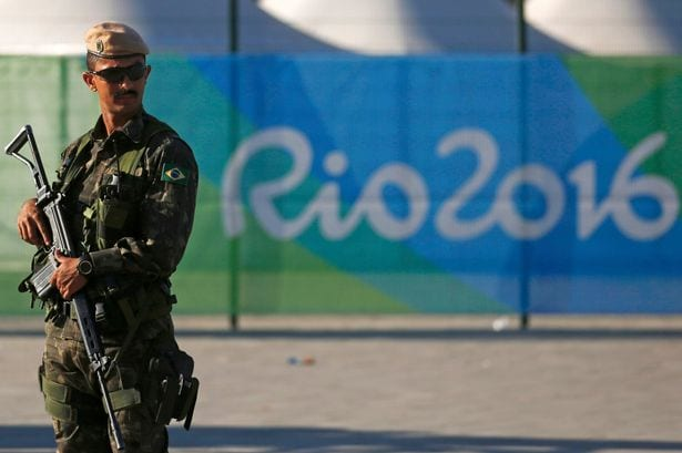 A-special-police-forces-officer-stands-guard-outside-the-Olympic-Park-in-Rio-de-Janeiro