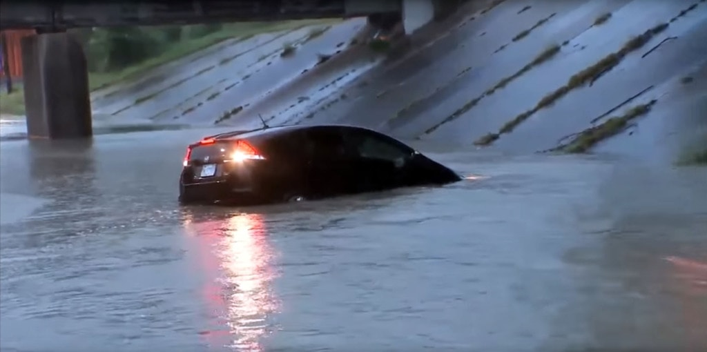 A car sinking in the water