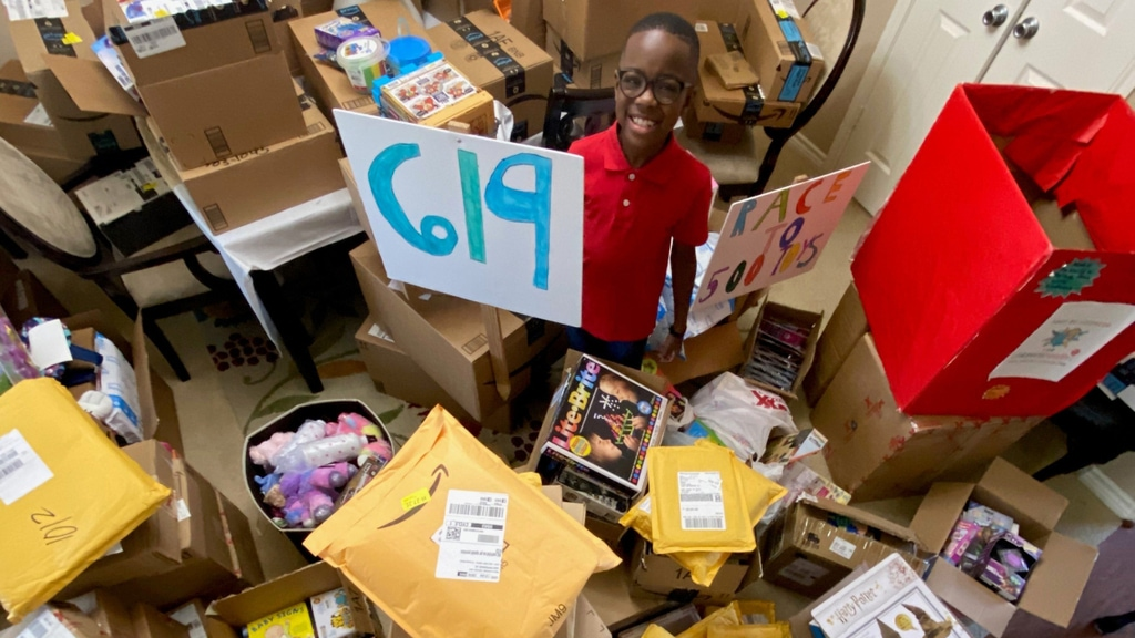 Orion Jean next to the toys he donated