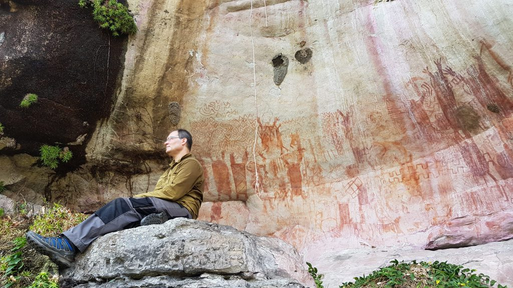 Researcher Amidst the Amazon Cave Paintings