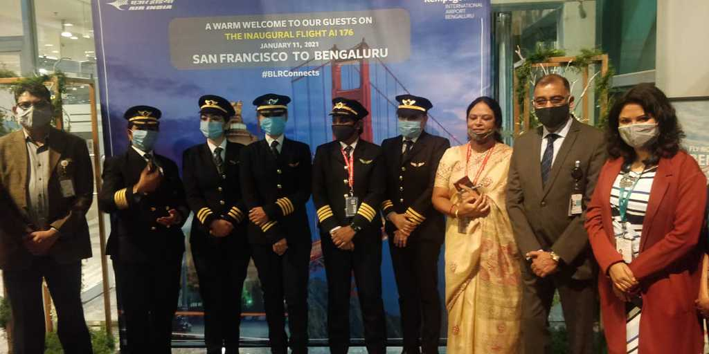 India's Minister of Civil Aviation, Hardeep Puri greeting the all-female crew