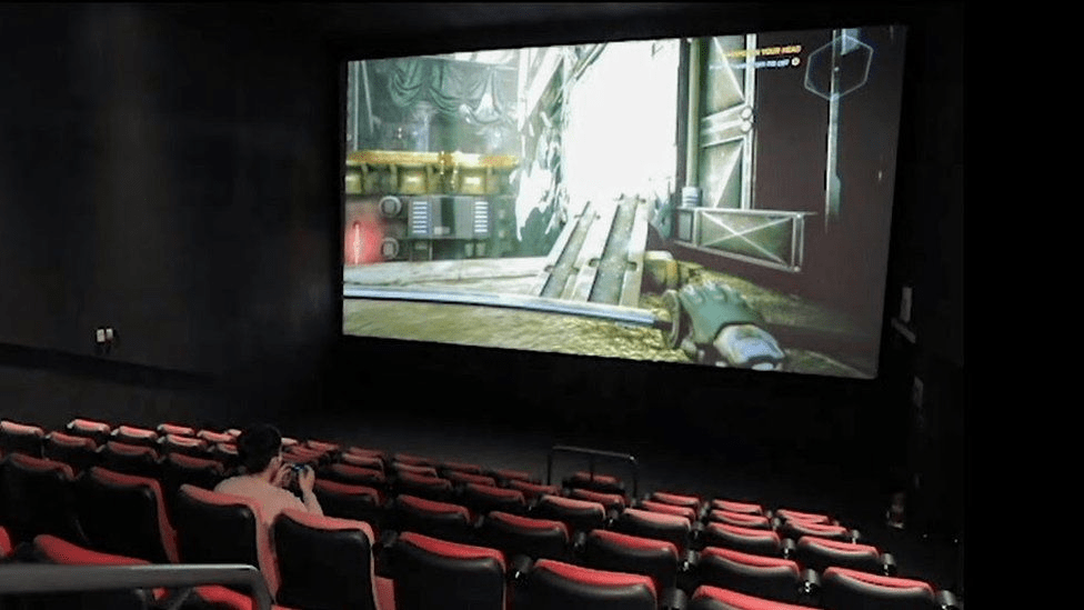 Gamers can enjoy playing video games on huge screens with high-definition audio.