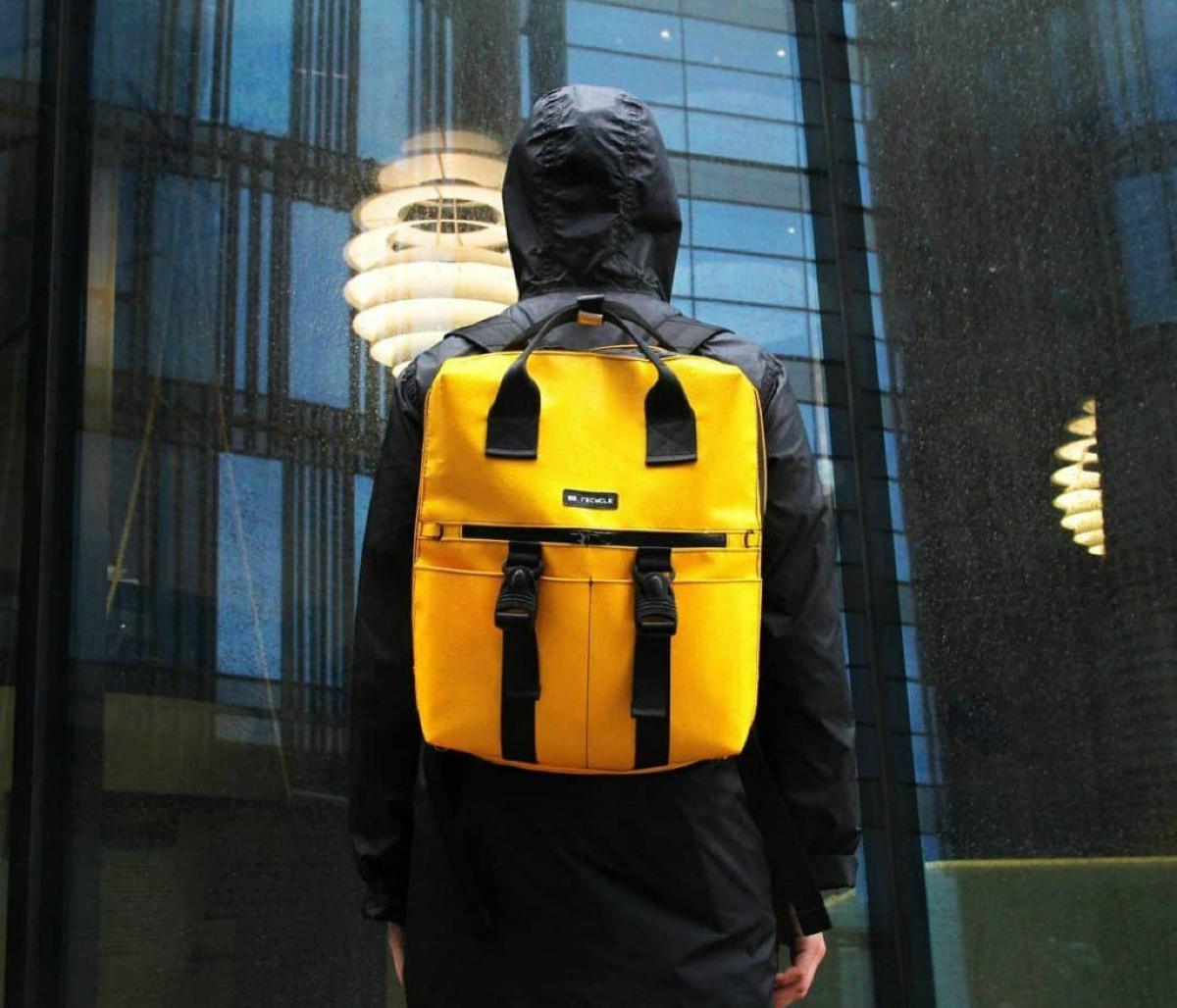 A yellow backpack made from recycled materials by the brand 99recycle in Russia