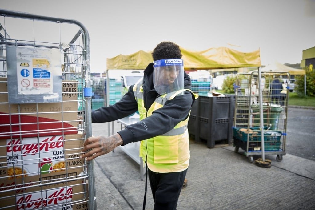 Rashford helping with food distribution at a food bank.