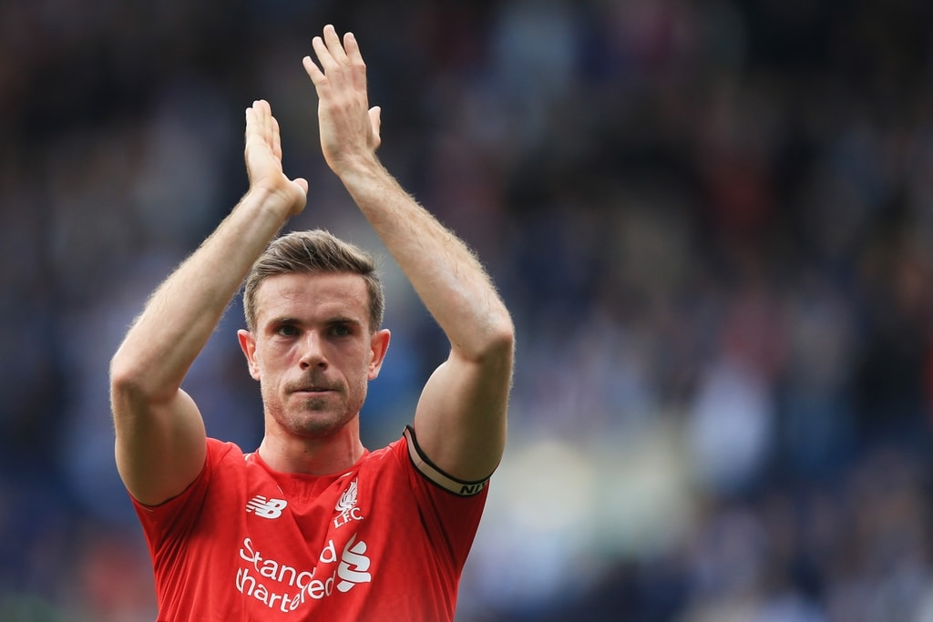 Jordan Henderson greeting the crowd after a Liverpool match.